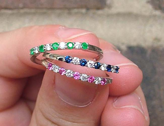emerald, sapphire and ruby rings
