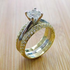 yellow gold wedding bands with minimalist engagement ring