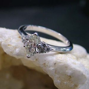 custom white gold engagement ring with thin band