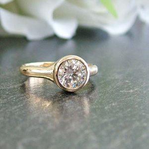 minimalist engagement ring with bezel style setting