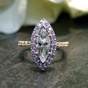 minimalist marquise shaped custom engagement ring with purple diamonds