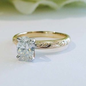 lab grown oval diamond with a custom engraved band dublin ohio jewelry store