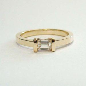 minimalist engagement ring with bar set band